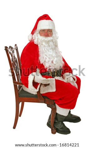 Santa Claus holds his hand out to YOU the Viewer as a Friendly Jesture  isolated on white