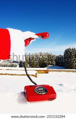Santa Claus Hotline symbolized by a red retro phone - stock photo