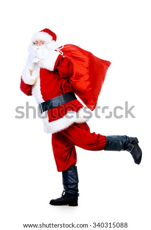 Santa Claus in a hurry with gifts for the holiday. Christmas celebration. Isolated over white. - stock photo