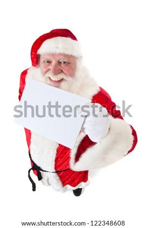 Santa Claus in authentic costume holding blank white placeholder. All on white background.
