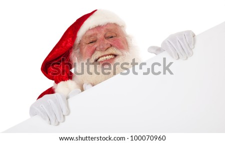 Santa Claus in authentic look behind white sign. All on white background. - stock photo