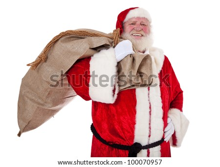 Santa Claus in authentic look carrying bag of presents. All on white background.