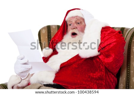 Santa Claus in authentic look reading wish list with surprised facial expression. All on white background.