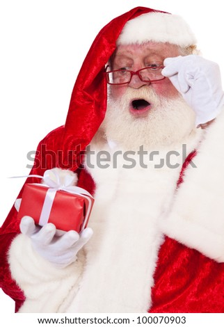 Santa Claus in authentic look with surprised expression. All on white background.
