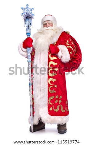 Santa Claus in full growth with a staff and a bag - stock photo