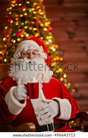 Santa Claus in his house