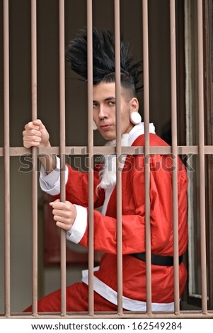 Santa Claus is behind bars in jail  - stock photo