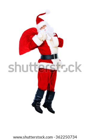 Santa Claus is jumping with gifts. Christmas time. Isolated over white. - stock photo
