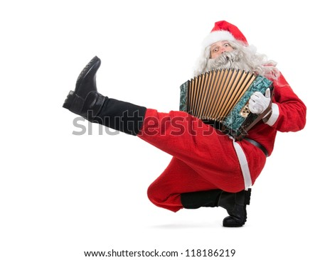Santa Claus Is Playing Music On The Accordion When Dancing Cossack Dance.  Santa Dancing Traditional