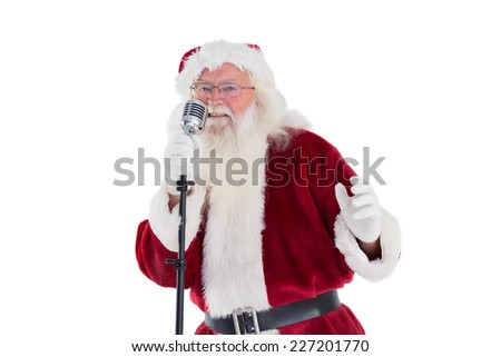 Santa Claus is singing Christmas songs on white background - stock photo
