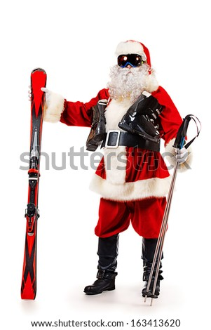 Santa Claus is standing in the ski mask and holding a skiing. Christmas. Isolated over white. - stock photo