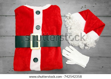 Santa Claus jacket with a Santa hat, beard and white gloves for Christmas.