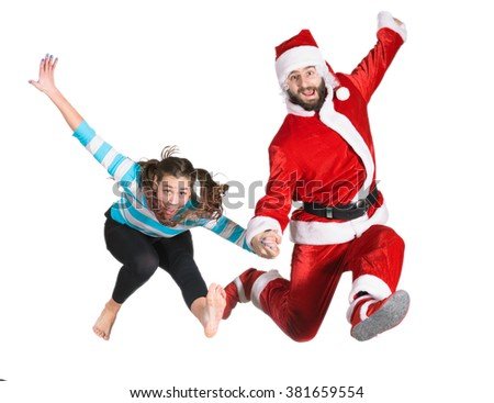 Santa Claus Jump with girl - stock photo
