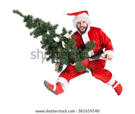 Santa Claus Jump with tree - stock photo