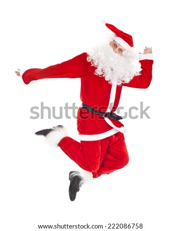 Santa Claus jumping, isolated on white background