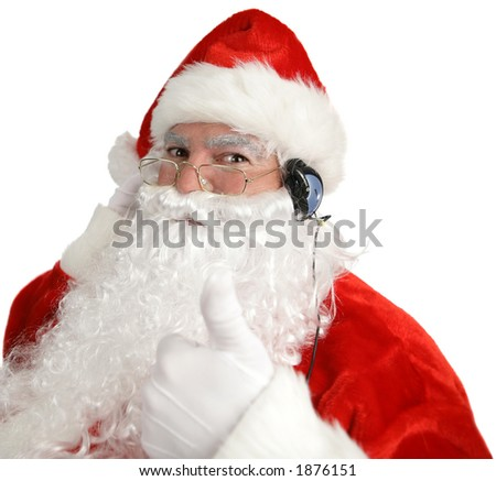 Santa Claus listening to headpnones and giving a thumbs up sign.  Isolated on white. - stock photo