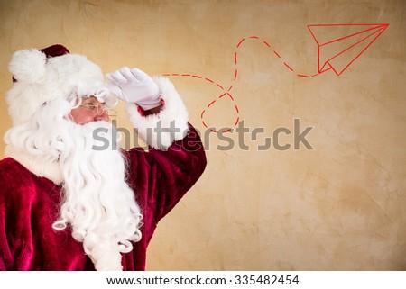 Santa Claus looking ahead. Christmas holiday concept - stock photo