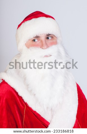 Santa Claus looks from the camera aside - stock photo