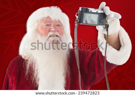 Santa Claus makes a selfie against red background