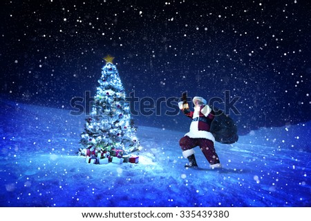Santa Claus Night Christmas Season Snowing Concept - stock photo