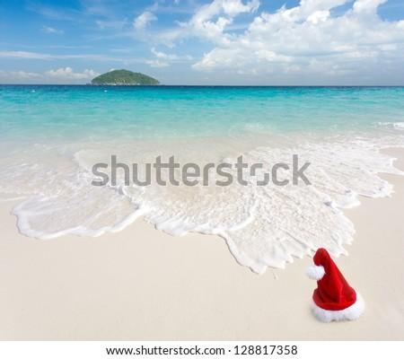Santa Claus on white sand tropical beach, ko similan island, Thailand - stock photo