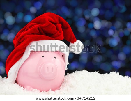 Santa Claus piggy bank on snow
