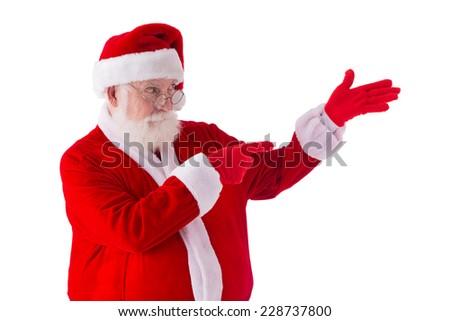 Santa Claus pointing at his empty hand - stock photo
