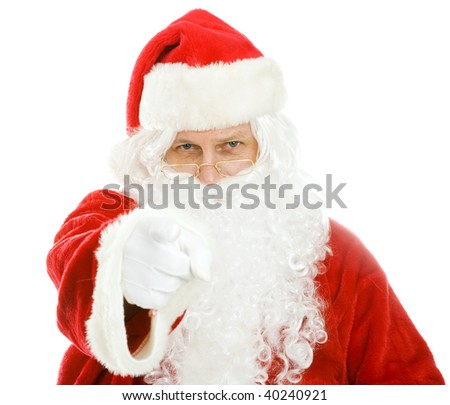 Santa Claus pointing at you.  Isolated on white.