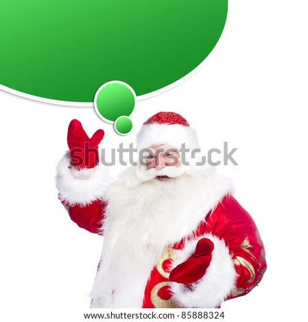 Santa Claus pointing his hand isolated over white. Blank graphic balloon for your text and logo with lots of copyspace overhead - stock photo