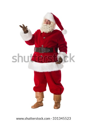 Santa Claus pointing to the left side Full Length Portrait. Isolated on White Background