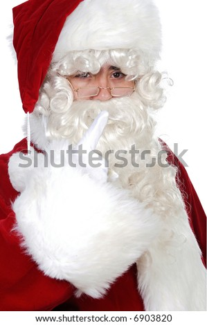 Santa Claus pointing with his finger over white background