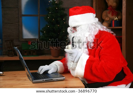 "Santa Claus points to his laptop computer, with ""room for your text"""