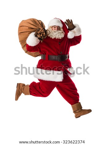 Santa Claus Portrait running with sack Isolated on White Background - stock photo