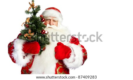Santa Claus portrait smiling isolated over a white background holding christmas tree - stock photo