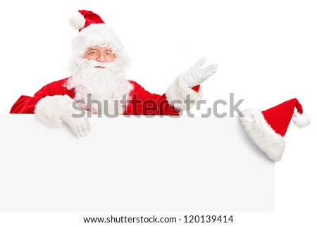 Santa Claus posing behind a billboard and gesturing isolated against white background