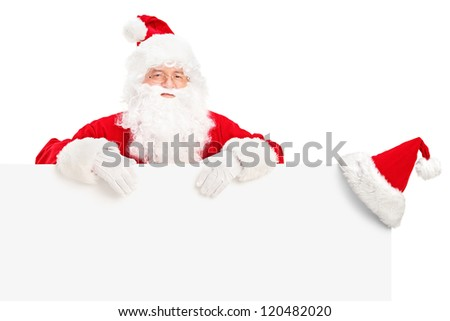 Santa Claus posing behind a blank billboard isolated on white background
