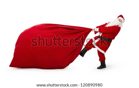 Santa Claus pulling huge bag full of christmas presents isolated on white background - stock photo