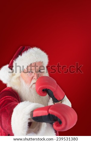 Santa Claus punches with his right against red background