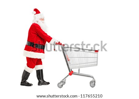 Santa Claus pushing an empty shopping cart isolated on white background - stock photo
