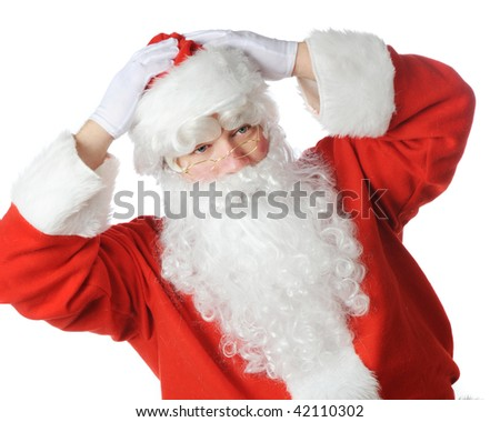 Santa Claus putting on his hat, ready for work on Christmas Eve.  Isolated on white.