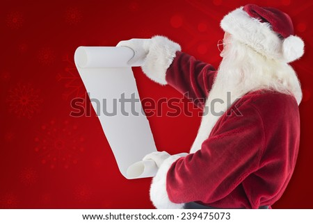 Santa Claus reads a list against red background