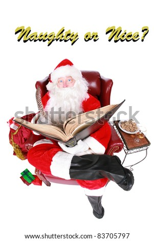 """Santa Claus reads from his book of Who has been """"Naughty or Nice"""" isolated on white with room for your text. Shot with a Fisheye lens for a fun festive image. - stock photo"""