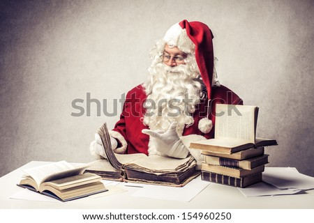 Santa Claus reads old books - stock photo
