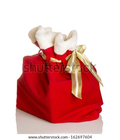 Santa Claus red bag full, on white background. - stock photo