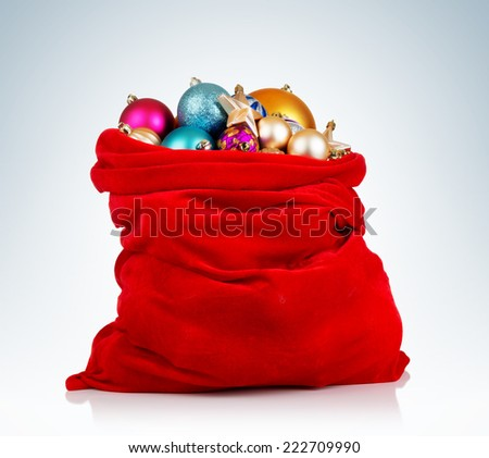 Santa Claus red bag with Christmas toys on background. - stock photo