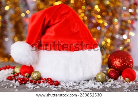 Santa Claus red hat on lights background - stock photo