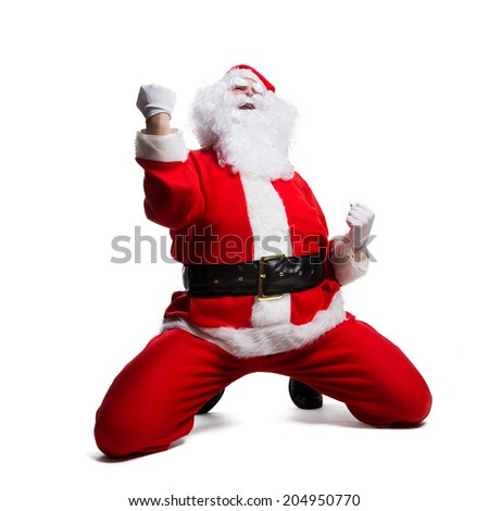 Santa Claus rejoicing - stock photo