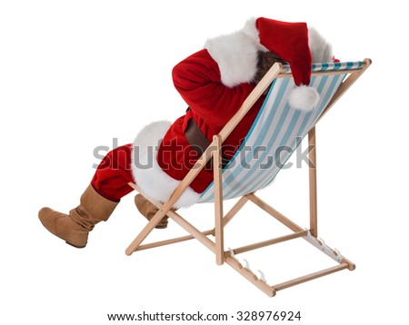 Santa Claus resting on deck chair Full-Length Portrait - stock photo