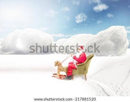 Santa Claus ride a fake deer on polar situation - stock photo