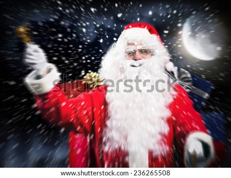 Santa Claus riding his sled in the Christmas night - stock photo